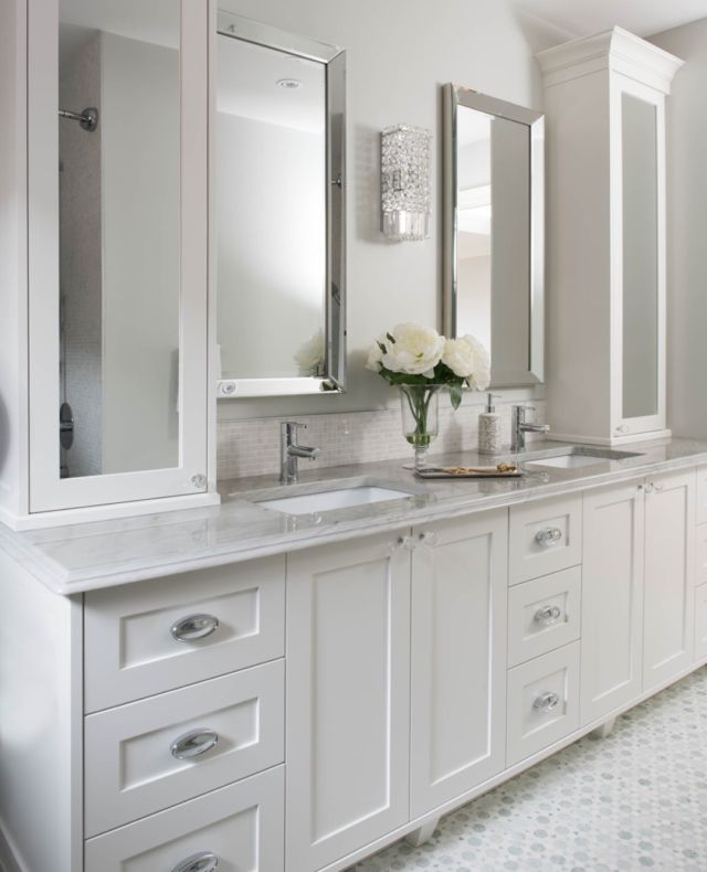 When you have a narrow bathroom, often found in older city homes or condos. It can be a challenge to create a highly functional space that also looks great.⠀ ⠀ With a few clever design tricks, we make your bathroom look and feel more spacious, transforming it into the beautiful, practical and relaxing space you've always wanted.⠀ ⠀ You might not be able to tell from this photo, but this bathroom is a very narrow space. Here's what we did to maximize space and make it feel more open 👇 ⠀ We used white cabinets and light tiles with white grout to open up the space. ⠀ ⠀ Included lots of natural light- replaced the window and even installed a skylight. ⠀ ⠀ Added lots of mirrors. The more light you can reflect, the bigger the bathroom will look.⠀ .⠀ .⠀ .⠀ .⠀ .⠀ #dvirainteriors #masterbath #luxurybathrooms #doublevanity #doublesink #narrowbathroom #whitetile #torontohome#bathroomdesign #luxuryhomes #bathroomdesign #bathroomdecor #bathremodel #masterbathroom #masterbathroomdesign #remodel #interiordesign #bathroomdesign #bathroominteriors #interiordesigner #designer #whitebathroom #bathbomb #spabathroom #spabath #bathroomjacuzzi #jacuzzitub #luxurybathroom