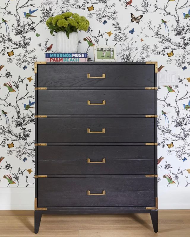 This is a stylish bedroom storage nook any kid would adore! ⠀ In this room, we had several fun patterns come together for a stylish mix. We paired the simple dark wood dresser with delicate custom gold hardware. The floral wallpaper, a true statement piece in this room, inspires creativity and sparks imagination. ⠀  Project- Sandringham .⠀ . . .⠀ .⠀ .⠀ .⠀ .⠀ .⠀ #dvirainteriors #luxuryrealestate #luxurylifestyle #kidsbedroom #kidsspace #kidsbed #kidsroominspo #torontodesigner #torontointeriordesign #kidsroom #kidsbedroom #kidsinteriors #floralwallpaper #designthinking #bedroominspo #kidsbedroomdecor #kidsroominspiration #interioraccessories #bedroomdesign #bedroomideas #girlsbedroom#beautifulinterior #contemporarybedroom #stylishwallpaper