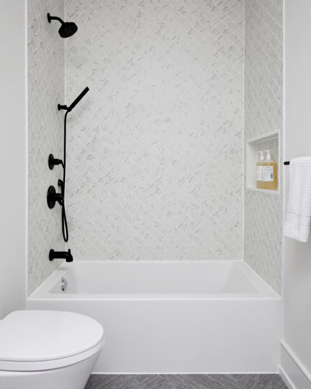 Having a connected bathroom otherwise known as a Jack and Jill bathroom that serves two bedrooms can help you use available square footage more efficiently and could free up space in your layout for bigger rooms, more storage, another room, etc.  The Jack and Jill bathroom pictured here is from project Davisville. In custom home projects, we like to incorporate shared bathrooms as they help the household handle multiple people more efficiently. These types of bathroom arrangements are ideal for large families.  We put a modern contemporary spin in this bathroom by using a combination of dark and light materials.   For the shower wall, we created texture by using marble fish scale tiles. The marble tiles create a dynamic and unique look that other more simple tiles wouldn't be able to achieve.   We decorated the space with matte black hardware and faucets for a bold effect!   Learn more about project Davisville on our website 👇 www.dvira.com/galleries/davisville  Are you looking to create your dream home? Ensure the careful smart planning you need from day one, and contact Dvira Interiors!   We look forward to incorporating our vision, scope, technical expertise, and industry connections to make your home's design/build experience as positive and rewarding as possible.  www.dvira.com . .⠀⠀ .⠀⠀ .⠀⠀ .⠀⠀ .⠀ .⠀ .⠀⠀ #dvirainteriors #torontodesigner #bathroomdesign ⠀ #torontomansion #bathroomvanity #blackhardware #marblebathroom #torontointeriordesign #spabathroom  #bathroomdesigns #livingbathrooms #yourfuturebathroom #architecturelovers #interiordesign #luxurydesign #luxurydesigner #interiordesigner #interiorismo #bathroomdesigns #luxuryhome #whitebathroom #marblebathroom⠀ #bathroomescape #bathroomdecoration #bathroomgoals #bathroomdesigns #dreambathroom #myhousebeautiful